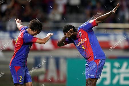 Stock Image of (L to R) Sei Muroya (FC Tokyo), Peter Utaka (FC Tokyo) celebrate