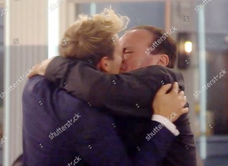Sam Thompson kissing Shaun Williamson during a game of Spin The Bottle