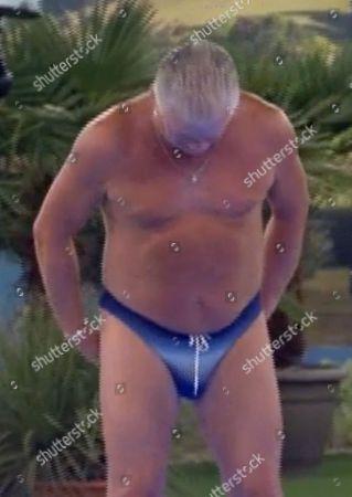 Derek Acorah gets in the pool