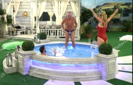 Derek Acorah gets in the pool with Chad Johnson and Sarah Harding