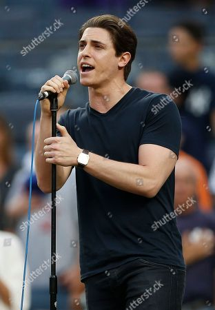"""Derek Klena star of """"Anastasia"""" on Broadway, sings the national anthem before a baseball game between the New York Mets and the New York Yankees, at Yankee Stadium in New York"""
