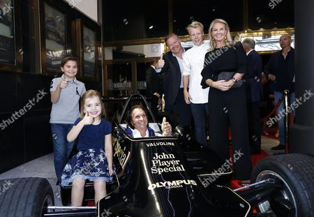 Emerson Fittipaldi, with his children Emerson and Vittoria, Nina Kennedy Peterson, with her husband Calle Kennedy, and the original Lotus F1 car that Ronnie Peterson drove in 1978