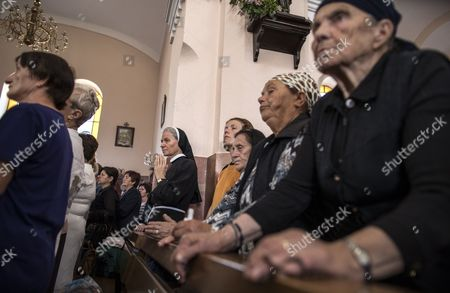 Pilgrims attend a mass of feast of the Black Madonna in Letnica, Kosovo, 15 August 2017. Thousands of pilgrims gather every year in the south-east village of Letnica to mark the feast of the Black Madonna,  a statue of blackened wood, which it is believed was carved more than 400 years ago in the style of Michelangelo. Mother Teresa, In 1928, when she was 17, she came to Letnica and it was while she was on this pilgrimage with her parents that she decided to become a missionary and dedicate her life to charity, said the head of the Catholic Church in Kosovo, Don Gjergj, during the mass. Many claim to have seen tears coming from the statue?s eyes during the celebration while others say they have experienced miraculous cures. Infertile couples, both Muslims and Christians, visit the effigy to get with child.