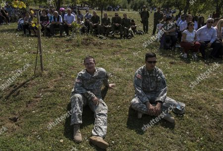 US soldiers serving in the NATO peacekeeping mission attend the feast of the Black Madonna in Letnica, Kosovo, 15 August 2017. Thousands of pilgrims gather every year in the south-east village of Letnica to mark the feast of the Black Madonna,  a statue of blackened wood, which it is believed was carved more than 400 years ago in the style of Michelangelo. Mother Teresa, In 1928, when she was 17, she came to Letnica and it was while she was on this pilgrimage with her parents that she decided to become a missionary and dedicate her life to charity, said the head of the Catholic Church in Kosovo, Don Gjergj, during the mass. Many claim to have seen tears coming from the statue?s eyes during the celebration while others say they have experienced miraculous cures. Infertile couples, both Muslims and Christians, visit the effigy to get with child.