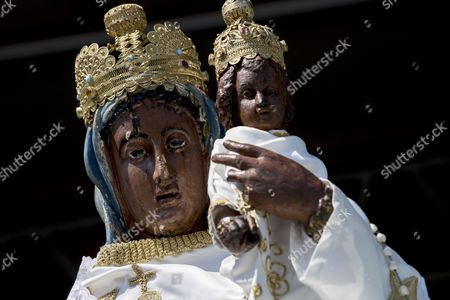 Statue of blackened wood of the Black Madonna is seen during the feast in Letnica, Kosovo, 15 August 2017. Thousands of pilgrims gather every year in the south-east village of Letnica to mark the feast of the Black Madonna,  a statue of blackened wood, which it is believed was carved more than 400 years ago in the style of Michelangelo. Mother Teresa, In 1928, when she was 17, she came to Letnica and it was while she was on this pilgrimage with her parents that she decided to become a missionary and dedicate her life to charity, said the head of the Catholic Church in Kosovo, Don Gjergj, during the mass. Many claim to have seen tears coming from the statue?s eyes during the celebration while others say they have experienced miraculous cures. Infertile couples, both Muslims and Christians, visit the effigy to get with child.