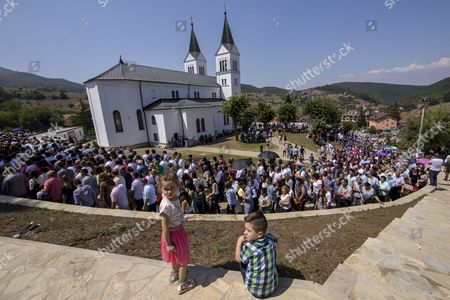 Pilgrims attend the feast of the Black Madonna in Letnica, Kosovo, 15 August 2017. Thousands of pilgrims gather every year in the south-east village of Letnica to mark the feast of the Black Madonna,  a statue of blackened wood, which it is believed was carved more than 400 years ago in the style of Michelangelo. Mother Teresa, In 1928, when she was 17, she came to Letnica and it was while she was on this pilgrimage with her parents that she decided to become a missionary and dedicate her life to charity, said the head of the Catholic Church in Kosovo, Don Gjergj, during the mass. Many claim to have seen tears coming from the statue?s eyes during the celebration while others say they have experienced miraculous cures. Infertile couples, both Muslims and Christians, visit the effigy to get with child.