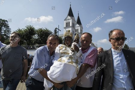 Pilgrims carry the Black Madonna during the feast in Letnica, Kosovo, 15 August 2017. Thousands of pilgrims gather every year in the south-east village of Letnica to mark the feast of the Black Madonna,  a statue of blackened wood, which it is believed was carved more than 400 years ago in the style of Michelangelo. Mother Teresa, In 1928, when she was 17, she came to Letnica and it was while she was on this pilgrimage with her parents that she decided to become a missionary and dedicate her life to charity, said the head of the Catholic Church in Kosovo, Don Gjergj, during the mass. Many claim to have seen tears coming from the statue?s eyes during the celebration while others say they have experienced miraculous cures. Infertile couples, both Muslims and Christians, visit the effigy to get with child.