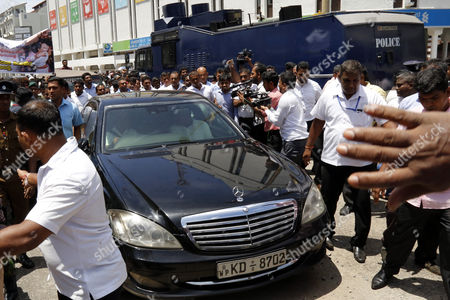 A vehicle carrying Sri Lanka's former president Mahinda Rajapaksa and his spouse former First Lady Shiranthi Rajapaksa leaves the Sri Lanka Police Criminal Investigation Department in Colombo, Sri Lanka, 15 August 2017. Mrs. Shiranthi Rajapaksa and her son Yoshitha Rajapaksa were summoned before the Criminal Investigation Department for the third time over the investigations into the death of a local rugby player Wasim Thajudeen who was killed in a car collision near his home at Narahenpita, Colombo on 17 May 2012.