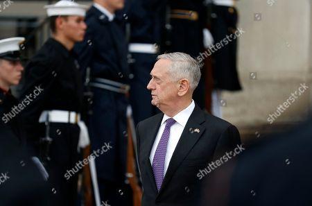 Defense Secretary Jim Mattis stands as he waits for Netherlands Minister of Defense Jeanine Hennis-Plasschaert during an enhanced honor cordon at the Pentagon, in Washington