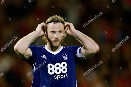 Nottingham Forest's Matthew Mills adjusts his hair band