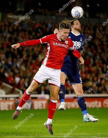 Barnsley's Angus MacDonald wins a header against Nottingham Forest's Matthew Mills