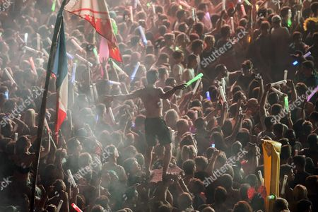 Fans enjoy the concert of the Belgian DJ and record producer duo Dimitri Vegas and Like Mike at the 25th Sziget (Island) Festival on Shipyard Island, Northern Budapest, Hungary, 15 August 2017 (issued 16 August 2017). The festival is one of the biggest cultural events of Europe offering art exhibitions, theatrical and circus performances and above all music concerts over eight days. Performers from over 52 countries will entertain nearly 500 thousands visitors during the event.