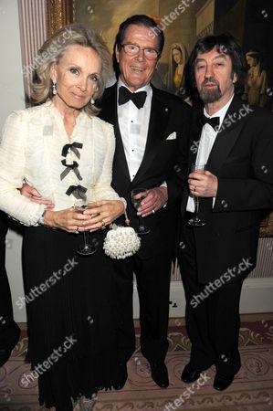 Sir Roger Moore, Christina 'Kiki' Tholstrup and Trevor Nunn