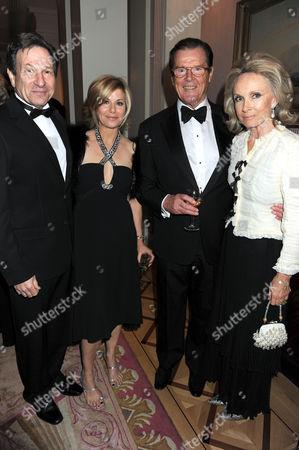 Michael Brandon, Glynis Barber and Sir Roger Moore and his wife Christina 'Kiki' Tholstrup