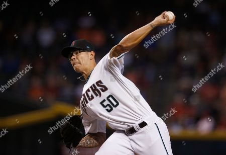 Arizona Diamondbacks' Anthony Timur Yunusov throws a pitch against the Houston Astros during the first inning of a baseball game, in Phoenix