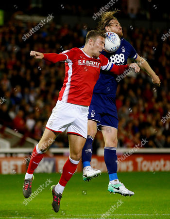 Barnsley's Angus MacDonald challenges Nottingham Forest's Matthew Mills