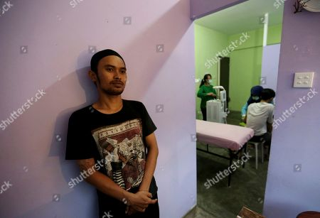 Taufiq Hidayat waits for his turn to get laser tattoo removal treatment at a clinic in Tangerang, Indonesia. Hidayat, a former gang member who has a newfound zeal for Islam that includes the conviction that Muslims should not alter the body that God gave them, took the offer from the clinic that provide tattoo removal for free on one condition: while being zapped, patients must read and learn by heart Surah Ar-Rahman, the 55th chapter of the Quran about God's gifts to man
