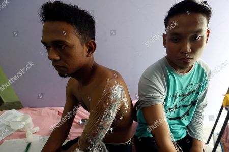 "Patients wait for their turn to receive laser tattoo removal treatment at a clinic in Tangerang, Indonesia. The clinic in the outskirt of the Indonesian capital is offering laser removal of tattoos for free to Muslims who want to go ""hijrah"" or to ""move closer to God"" on one condition: while being zapped, patients must read and learn by heart Surah Ar-Rahman, the 55th chapter of the Quran about God's gifts to man"