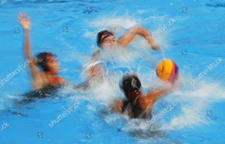 A picture taken with slow shutter speed of Koh Xiao Li (C) of Singapore in action against Malaysian players Sarah-Ann Thorp (up), Aileen Lim Zhixiang (bottom), and Mak Sin Sin (L) during the SEA Games 2017 women's water polo events in Kuala Lumpur, Malaysia, 16 August 2017.