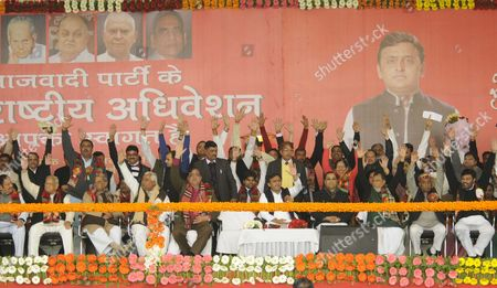 LUCKNOW, INDIA - JANUARY 1: Uttar Pradesh Chief Minister Akhilesh Yadav along with party leaders at special emergency National convention of the party convened at Janeshwar Mishra Park, on January 1, 2017 in Lucknow, India. Party leaders congratulated Chief Minister Akhilesh Yadav after his appointment as national president of the party. A day after he forced his way back into the party, Akhilesh Yadav was appointed, by the national executive of the SP, as the new chief of the party and Mulayam Singh Yadav kicked upstairs as mentor.