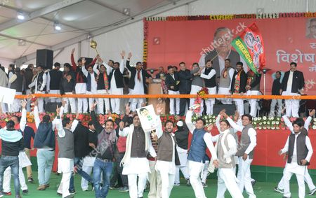 LUCKNOW, INDIA - JANUARY 1: Samajwadi Party workers celebrate after UP Chief Minister Akhilesh Yadav elected party's national president unanimously during Samajwadi party national convention at Janeshwar Mishra Park, on January 1, 2017 in Lucknow, India. Party leaders congratulated Chief Minister Akhilesh Yadav after his appointment as national president of the party. A day after he forced his way back into the party, Akhilesh Yadav was appointed, by the national executive of the SP, as the new chief of the party and Mulayam Singh Yadav kicked upstairs as mentor.
