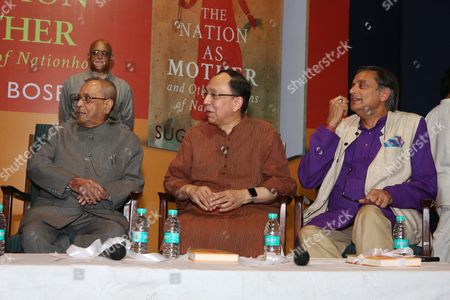 """NEW DELHI, INDIA - AUGUST 10: (L-R) Former President of India Pranab Mukherjee, Sugata Bose and Congress MP Shashi Tharoor during the launch of a book, """"The Nation as Mother And Other Visions of Nationhood"""", by historian and politico, Sugata Bose, at Teen Murti Auditorium, on August 10, 2017 in New Delhi, India. The book includes researched essays and speeches that discuss India, its political evolution and more."""