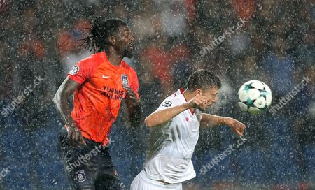 Basaksehir Istanbul's Emmanuel Adebayor (L) in action against Sevilla FC's Clement Lenglet (R) at the UEFA Champions League first leg  play-off soccer match between Basaksehir Istanbul's and Sevilla FC in Istanbul, Turkey, 16 August 2017.