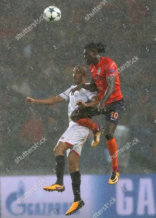 Basaksehir Istanbul's Emmanuel Adebayor (R) in action against Sevilla FC's Guido Pizarro (L) during the UEFA Champions League first leg play-off soccer match between Basaksehir Istanbul and Sevilla FC in Istanbul, Turkey, 16 August 2017.
