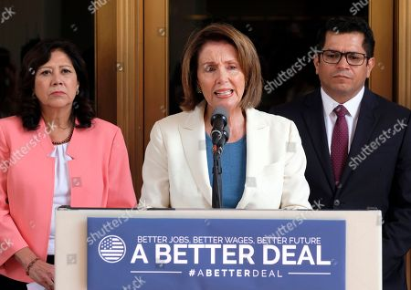 House Democratic Leader Nancy Pelosi from Calif., center, is joined by Rep. Jimmy Gomez, D-Calif., right, and Rep. Hilda Solis, D-Calif., during a news conference at Union Station in Los Angeles on . Pelosi is criticizing Republicans who haven't spoken out against President Donald Trump's comments on white supremacists
