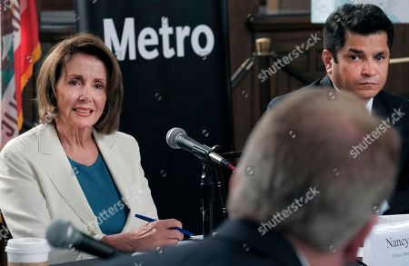 """Jimmy Gomez, Nancy Pelosi House Democratic Leader Nancy Pelosi from California, left and Rep. Jimmy Gomez, D-Calif., right answers question during an infrastructure roundtable meeting at Union Station in Los Angeles on . Pelosi is criticizing Republicans who haven't spoken out against President Donald Trump's comments on white supremacists. Speaking in Los Angeles the Democratic leader said there is a """"deafening silence"""" from most of her Republican colleagues"""