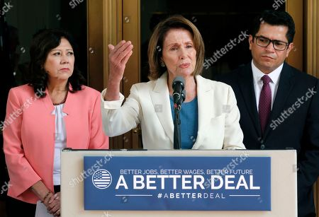 """House Democratic Leader Nancy Pelosi from California, center, is joined by Rep. Jimmy Gomez, D-Calif., right, and Rep. Hilda Solis, D-Calif., during a news conference at Union Station in Los Angeles on . Pelosi is criticizing Republicans who haven't spoken out against President Donald Trump's comments on white supremacists. Speaking in Los Angeles the Democratic leader said there is a """"deafening silence"""" from most of her Republican colleagues"""
