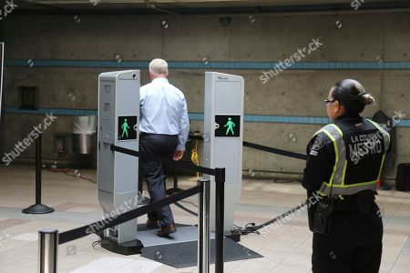 Stock Picture of Chris McLaughlin, a vice president with Evolv Technology, test the company's body scanner at Union Station subway station in Los Angeles . Passengers boarding subway trains in Los Angeles may soon be shuffled through airport-style body scanners that are aimed to detect firearms and explosives. A two-day pilot program by the Los Angeles Metropolitan Transportation Authority, Metro began Wednesday at Union Station. Officials say the machines can scan about 600 people per hour