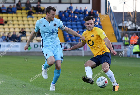 Mark Ricketts (4) of Boreham Wood & Jake Gosling (11) of Torquay United competes for the ball, Vanarama National League match between Torquay United and Boreham Wood on Tuesday 15th August 2017 at Plainmoor, Torquay, Devon
