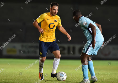 Jake Gosling (11) of Torquay United competes for the ball with Kieran Murtagh (10) of Boreham Wood, Vanarama National League match between Torquay United and Boreham Wood on Tuesday 15th August 2017 at Plainmoor, Torquay, Devon