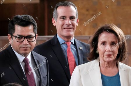 Eric Garcetti, Jimmy Gomez, Nancy Pelosi Los Angeles Mayor Eric Garcetti, center, is joined by Rep. Jimmy Gomez, D-Calif., left, and House Democratic Leader Nancy Pelosi, right arrive for an infrastructure roundtable meeting at Union Station in Los Angeles on