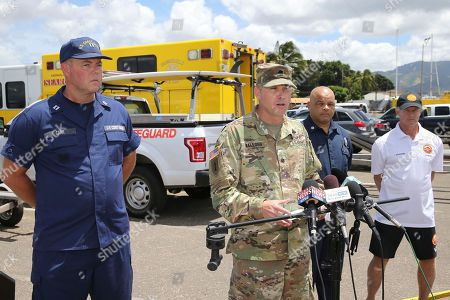 Curt Kellogg, Scott Carr, David Jenkins, John Hoogesteden Lt. Col. Curt Kellogg, spokesperson for the 25th Infantry Division, second from left, speaks at a news conference discussing the Army UH-60 Black Hawk helicopter crash in Haleiwa, Hawaii. The Black Hawk with five on board crashed several miles off Oahu's North Shore late Tuesday. Rescue crews are searching the waters early Wednesday. Also pictured, Lt. Scott Carr, of the US Coast Guard's 14th District, left, Capt. David Jenkins, spokesperson for the Honolulu Fire Department, second from right, and Lt. John Hoogesteden, of Honolulu Ocean Safety, right