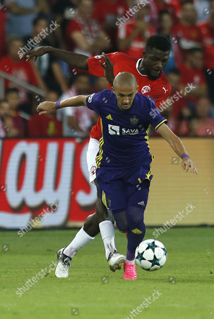 Valon Ahmedi (R) of Maribor vies for the ball with John Ogu (L) of H. Beer Sheva during the UEFA Champions League play off, match between H. Beer Sheva vs Maribor at Beer Sheva Stadium, Israel, 16 August 2017.