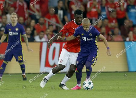 Valon Ahmedi (R) of Maribor vies for the balls with John Ogu (L) of H. Beer Sheva during the UEFA Champions League play off, match between H. Beer Sheva vs Maribor at Beer Sheva Stadium, Israel, 16 August 2017.