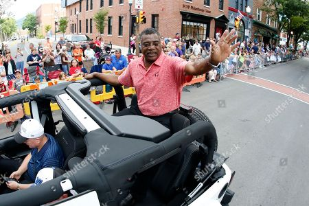 Baseball Hall of Famer Eddie Murray rides as the Grand Marshall of the Little League Grand Slam Parade in downtown Williamsport, Pa., . The Little League World Series tournament starts Thursday, Aug. 17, 2017 in South Williamsport, Pa