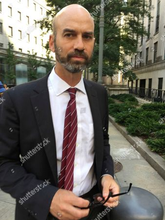 James Bennet, editorial page editor of The New York Times, leaves federal court, in New York. Bennet was grilled in federal court by a lawyer for Sarah Palin, who's suing over an editorial that linked right-wing political rhetoric to the 2011 shooting of former U.S. Rep. Gabby Giffords