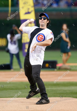 Actor Thomas Ian Nicholas throws out a ceremonial first pitch before a baseball game between the Chicago Cubs and the Cincinnati Reds, in Chicago