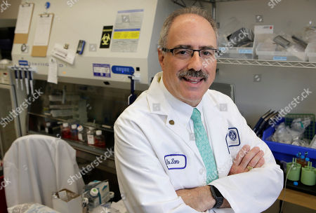 Researcher Leonard Zon, founder and director of the Stem Cell Program at Boston Children's Hospital, stands for a photograph in a lab at the hospital, in Boston. Democratic Gov. Deval Patrick pushed through a $1 billion, 10-year life sciences initiative that helped pay for the stem cell program at the hospital