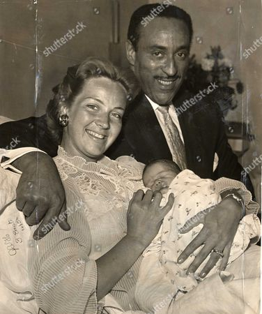 Ray Ellington Pictured With His Wife Anita And Their Son Lance Ellington At The Queen Charlotte Hospital. The Couple Divorced In July 196.