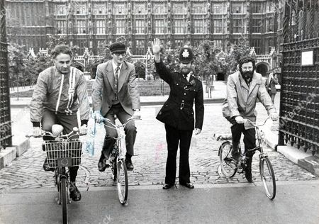 Cycling Mp's - A Police Officer Halts The Traffic Outside The Houses Of Parliament As Anthony Steen Mp (conservative Mp For Totnes & Secretary Of The Cycling Group) Sir George Young 36 (mp For Ealing And Acton) Andrew Bennett Mp (labour Denton And Reddish). Launch Of A New Rent-a-bike Pool For Mp's.