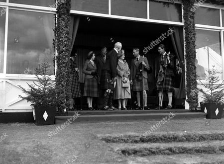 From Left: Elizabeth Farquharson Princess Margaret Prince Philip George Gordon 2nd Marquess Of Aberdeen The Queen Mother King George Vi And Alexander Farquharson At The Braemar Royal Highland Gathering. Glass Neg.