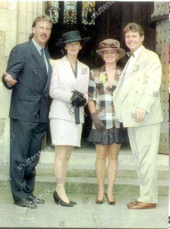 Cricketer - David Gower - Wedding 1992. Ian Botham With His Wife Kathy And Robin Smith With His Wife Cathy At David Gower's Wedding. He May Have Been Controversially Dropped From The England Tour Party But At Least Cricketer David Gower Was The Star Of The Wedding Party. Hundreds Of Well-wishers Cheered The Record-breaking Batsman As The Arrived At Winchester Cathedral Yesterday For His Marriage To Thorrun Nash. The Traditional Ceremony Was Attended By Some Ofthe Biggest Names In Sport And Showbusiness. The Traditional Ceremony Was Attended By Some Of The Biggets Names In Sport And Showbusiness. They Included Fellow England Stars Robin Smith Allan Lamb And Ian Botham As Well As. Bob Willis Gary Linekar Rory Bremner And Tim Rice. The Best Man Was Former England Captain Chris Cowdrey. One Notable Absentee Was Present Captain Graham Gooch Who Has Critisized 35-year-old Gower's Attitude To The Game. 'let's Say He Did'nt Make The Team' Was The Groom's Only Comment On The Matter. Thorrun A 34-year-old Dental Assistant Arrived At The Cathedral In A Midnight Blue Bentley And Wore An Ivory Dress In Full Train. After The 45-minute Service The Guests Were Given A Police Escort To The Reception At Nearby Launceston House Sparshott. **original Print Held In Box 20569289 **** Pkt5037-370156.