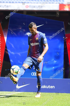 Jose Paulo Bezerra Paulinho plays with the ball during his presentation as new FC Barcelona.