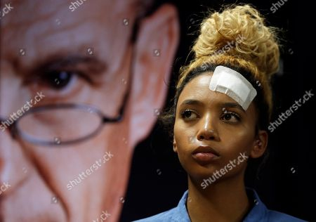 Gabriella Engels, looks on during a media conference in Pretoria, South Africa, . The model who accuses Zimbabwe's first lady of assault, 20-year-old Gabriella Engels, has been offered legal assistance by a prominent lawyer Gerrie Nel, who secured the murder conviction of Oscar Pistorius