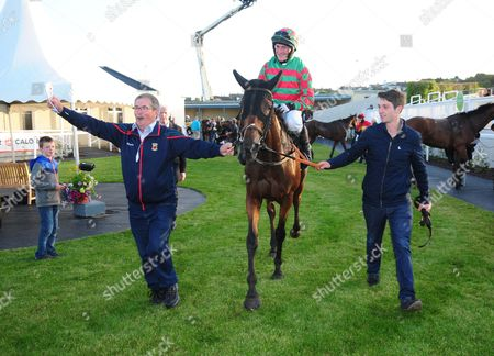 Stock Image of TRAMORE GRANNY BIDDY and Barry John Foley led in by owner Tom McNulty & Chris O'Donovan after winning the O'Neills Bar Handicap Hurdle. HEALY RACING