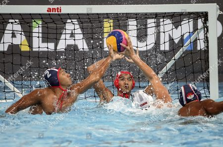Samuel Moses Yu Nan-Feng (C-R) of Singapore and Beby Willy Eka Paksi (L), Novian Dwiputra (C) and Silvester Goldberg Manik (R) of Indonesia in action during the SEA Games 2017 Water Polo events in Kuala Lumpur, Malaysia, 18 August 2017.